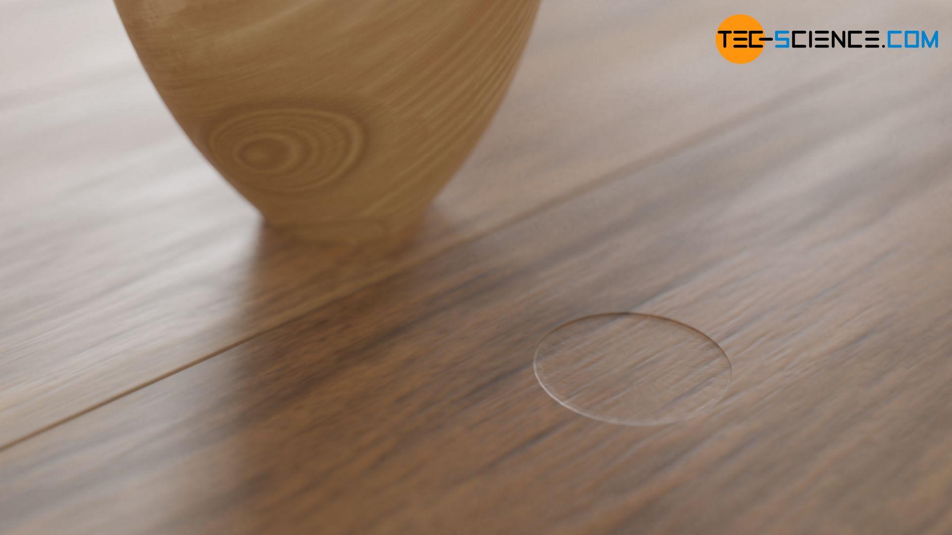 Druckstelle eines schweren Tisches auf einem Fußboden