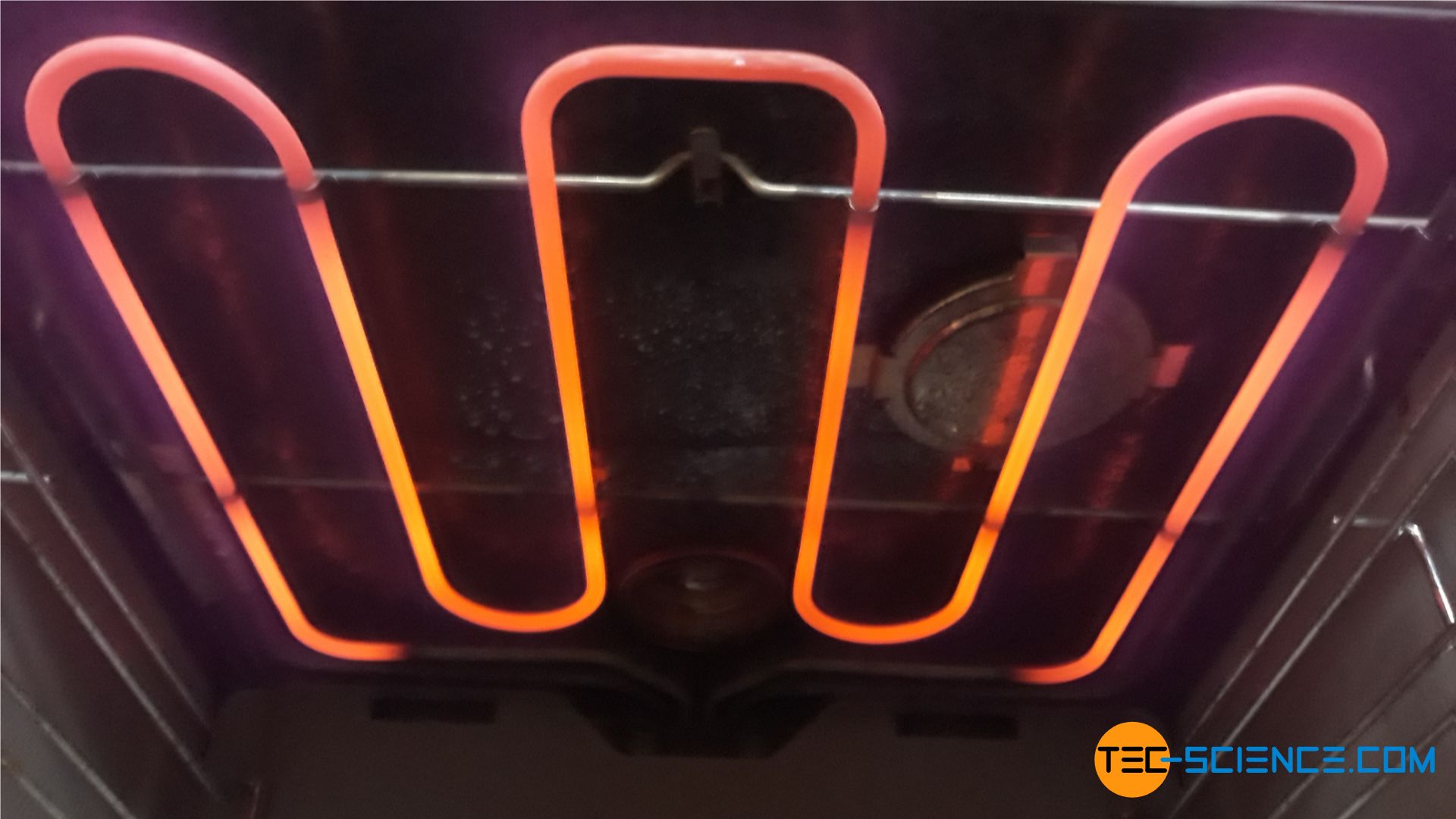 Red glow of the heating element of an oven